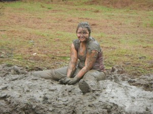 Lucy making mud angels