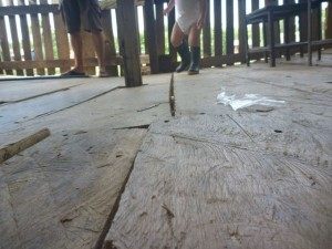Chainsaw cut flooring in the school house