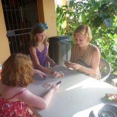 Trine from Norway playing cards with Ellie and Guin.  How our girls enjoyed spending time with the big girls and learning new things!