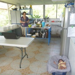 Jen making dinner and baby Begui in her makeshift crib.  Jen's creative idea. :)