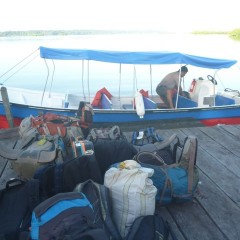 Loading up their bags on a JAMPAN water taxi
