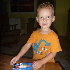 Ethan loves his Lego 'barco'