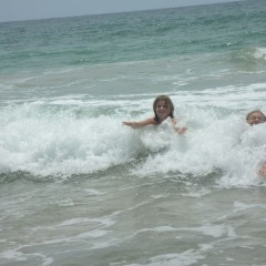 Ellie body-surfing with Macy